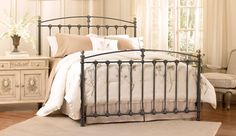 This traditional metal bed features decorative castings in a Dark Graphite finish with Dark Brass-plated finials. Available in King or Queen sizes