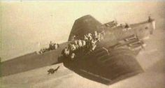 Soviet paratroopers jumping from a Tupolev TB-3