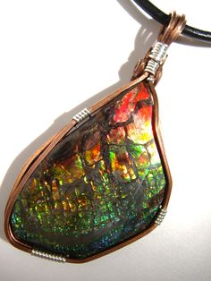 Ammolite wtih Copper and Silver Pendant by thanksloveart on Etsy Gemstone Jewelry, Unique Jewelry, Ammonite, Fossil, Zip Around Wallet, Copper, Gemstones, Trending Outfits, Pendant