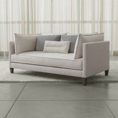 Elegant yet inviting, Asana reimagines the living room sofa in a sleek, tuxedo-style frame.  Sink-in cushions, bolsters and a kidney pillow layer three fabrics and textures—cotton blend, linen blend and velvet—in gracious harmony.