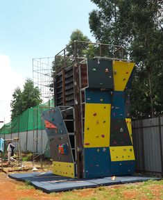 Measuring 8 ft wide x 16 ft high, this climbing wall was designed and built for FunScapes, an amusement part in Nairobi, Kenya. We built this climbing wall against a vertically stacked shipping container. It also has two bouldering walls on adjacent sides of the shipping container.  #FeetOffGround #ClimbingWall #BoulderingWall #RockClimbing #ShippingContainer #ShippingContainerConstructions #RepurposedShippingContainer Outdoor Fitness Equipment, No Equipment Workout, Climbing Wall, Rock Climbing, Children's Playground Equipment, Bouldering Wall, Ropes Course, Outdoor Workouts, Nairobi