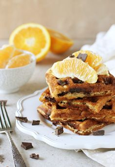Recipe for orange and dark chocolate waffles from @CMCAshley. Made with white whole wheat flour and coconut oil! Filled with orange zest and chopped dark chocolate!