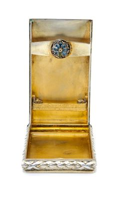 A Russian Guilloche Enamel and Silver Cigarette Case  Mark of Faberge with Imperial warrant, St. Petersburg, late 19th/early 20th century  the lid decorated with translucent yellow enameling on a sunburst guilloche ground radiating from a jeweled floral ornament, the sides with foliate and ribbon banding.