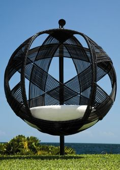 Sphere swing chair by Neoteric Luxury.  Recycled galvanized metal base sooo awesome
