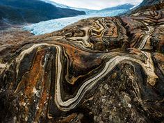 Near the edge of Engabreen glacier, the contortions of time are visible in the sinuous infolding of stone. (Photograph by Erlend Haarberg)