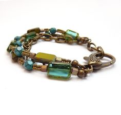 Multistrand Beaded Bracelet, Chunky Statement Bracelet, Mixed Metals, Teal, Turquoise & Green Picasso Glass, Funky Bronze Chain. $48.00, via Etsy.