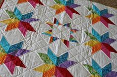 Rainbow starflower block quilt~Finding that I really love bright colors on white backgrounds...who knew?