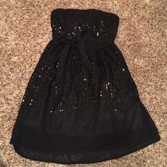 Forever 21 Black sequin dress Black sequin sheer (with underlay) strapless dress with a ribbon now that ties around the waist. Perfect for LBD! Date night, GNO, etc so cute on! Length to about mid thigh. Forever 21 Dresses Mini