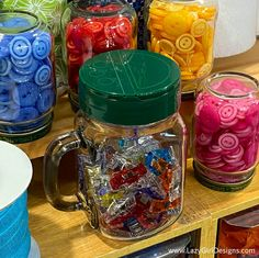 Guilt-Free hack for your sewing organization. Use cheese shaker top lids with regular jars for easy storage in the sewing room. #LazyGirlDesigns