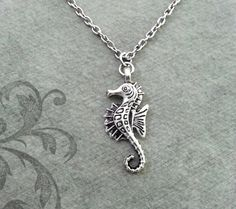 This listing is for a seahorse charm necklace. Youll be able to choose your chain length and style at checkout by using the Chain Length/Style drop-down menu. **Please see the second photo for scale! This is a VERY SMALL charm. If youre on the mobile site, just swipe to the side. :)   - - - - - - -  This is our third shop for jewelry. If youre looking for something a bit more personalized, then just follow these links:  www.etsy.com/shop/metalspeak  www.etsy.com/shop/metalspeaktoo…