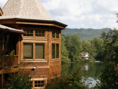 Excuse me…is this a log home with a turret and a lake?! (Can we delete the neighbouring house and have it?)