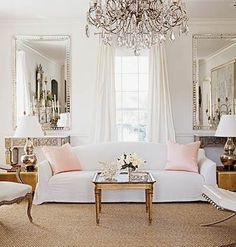 White couch with pale pink cushions