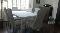 Urban dining table in matt white glass with Alex dining chairs in leather, as delivered to one of our London clients.