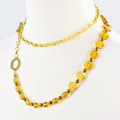 Live the drama with an adjustable double-wrap golden glass beaded necklace a full 40 inches long. Or give it to your favorite fashion adventurer.  This endlessly adjustable necklace can be worn in an almost infinite variety of arrangements. Gold finish chain connects oblong and disc-shaped beads punctuated by metallic golden beads to a gold-finish ring and matching toggle clasp.  The Smallest Planet Guarantee  All Smallest Planet jewelry is handmade by me, Sara Kelly, in my home studio in…