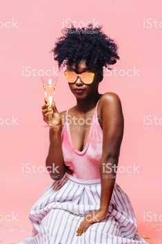 Cool girl with sunglasses holding champagne glass, isolated on pink - Royalty-free Cut Out Stock Photo Girl With Sunglasses, Pink Photo, Video Image, Magazine Articles, Feature Film, Photo Illustration, Royalty Free Images, Afro, Cool Girl
