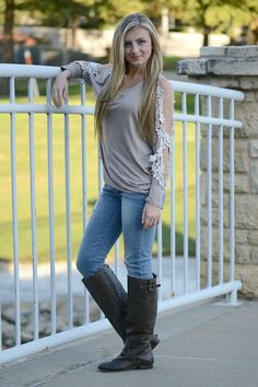 Super chic  top with lace cut-out sleeve design. Complete the look with our skinny jeans and boots.