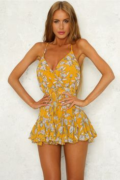 6c3a020eb04 Our Summer Of Love Playsuit has a crossover V neckline