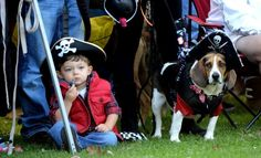 Sean Cleveland, 3, of Galloway Township, and his dog Snoopy are  dressed as pirates as watched the Halloween pet parade at The  Village Greene in Smithville.