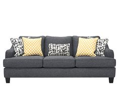 Who doesn't love furniture with personality? The Union Square queen sleeper sofa has just that, and offers an on-trend look that will liven up your living room. Its dark gray upholstery wraps around a frame that features track arms and piping, all of which create contemporary flair. Plus, reversible accent pillows let you customize your look!