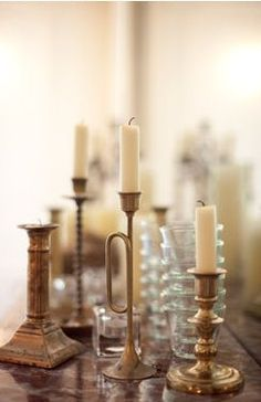 A multitude of candlesticks. Make sure you use a variety including metal and glass. Place all on a mirror tabletop to reflect the light again and again. Gold Home Decor, Home Design Decor, Vintage Soul, Candle Centerpieces, Christmas Fashion, Home Decor Inspiration, Decoration, Candlesticks, Decorative Accessories