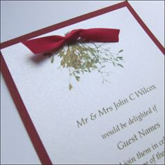 This two layer wedding invitation is finished with a satin ribbon and printed with mistletoe detail. Featured in White Micah and Jupiter Red with a red satin bow. £2.00 each available to purchase online.