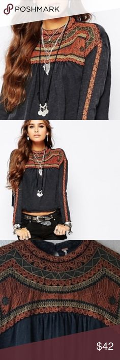 Free People Swing Top Embroidered detail Beautiful embroidery detail in this Free People top. Color is like a blackish/blue with burnt orange,camel, and grey threading. Detail goes down the sleeve as well. Gently used condition in size Medium. Free People Tops Crop Tops