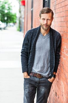 """""""There's something so comforting to me about seeing a man in a smoking jacket-style cardigan. I wanted to give the option of wearing the collar up, or folding it down for a shawled-collared effect. The deep ribbing at the placket keeps this cardigan casual and wearable for any occasion.""""– Michele Wang"""