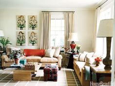 Pops of red. Design: Nancy Boszhardt. housebeautiful.com. #red #accent_colors #living_room