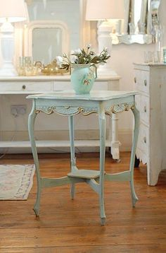 pretty little table with gilt trim