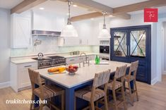 Peony White and blue painted cabinets from Grabill Cabinets in their Madison Square door style set a nautical tone in the kitchen. A paneled and mirrored refrigerator is a focal point in the design inviting light into the back corner of the kitchen. Chrome accents continue the sparkle throughout the space. Painted Cupboards, Family Kitchen, Transitional Kitchen, Painting Cabinets, Kitchen Styling, Cottage Style, Kitchen Design, Madison Square, Table