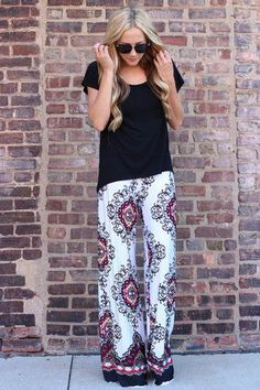 Love these casual flowy pants and how chic and cute they are.  Wear them with any top and you're done.  Grab a pair of similar printed patterned palazzo pants.