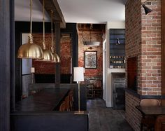 Exposed brick walls and sturdy timber beams frame the restaurant of Wm. Farmers & Sons in Hudson, New York. Image courtesy of SchappacherWhite Architecture. Photograph by Jason Lindberg.