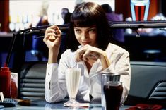 Uma Thurman as Mrs. Mia Wallace with her five-dollar milkshake in Quentin Tarantino's Pulp Fiction (1994).