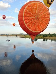 Orange Hot Air Balloon at the Putrajaya Hot-Air Balloon Festival in Malaysia - photo by mymodernmet