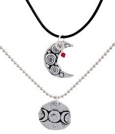 The original necklace pair for House of Night.  The top necklace is the crescent moon  and the longer length is the triple moon Dark Daughters design.  Shown here as a layered look.  These two original pieces were design in concert with PC Cast, Kristin Cast and the storyline from House of Night