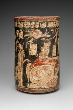 Cylinder vase. Maya, Late Classic Period A.D. 650–800. El Petén, Tikal - Uaxactún area, Guatemala. 25.4 x 15.3 cm. Black background vase with a painted scene of heart sacrifice of a male figure who may be Hun Hun Ajaw (the Maize god). -Museum of Fine Arts, Boston-