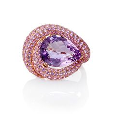 This exclusive 18k rose gold ring, features 1 pear cut purple amethyst, weighing 8.95 carats and 189 pink sapphires, of exquisite color, weighing 3.88 carats total.