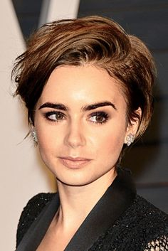 For an evening look, throw hair to one side with a deep part like Lily Collins. For extra texture, spritz on a sea salt spray throughout.