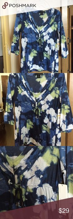 Calvin Klein top Floral Calvin Klein top with tie middle , 3/4 sleeve with elastic new with tags Calvin Klein Tops Blouses