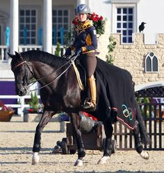 Morgan Barbançon of Spain, the youngest rider in the dressage competition at age 19, walking Painted Black. © 2012 Ken Braddick