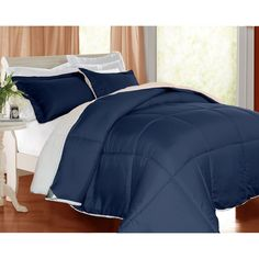 This hypoallergenic comforter set features a down alternative fill and microfiber construction. It comes in four bold colors to distinguish your bedroom with comfort and luxury.