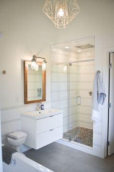 Floating cabinet (white) and shower tiling and lighting.
