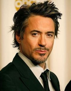 Robert Downey Jr is an American actor who made his screen debut at the age of five, appearing in his father Robert Downey, Sr.s film Pound. He has starred in Iron Man, The Avengers and Sherlock Holmes. Robert Downey Jr., Pretty People, Beautiful People, Iron Man, Hot Men, Hot Guys, Sexy Men, Mickey Rourke, Colin Farrell
