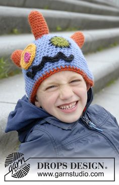 """Crochet DROPS monster hat with horns, eyes and mouth in """"Nepal""""."""