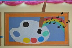 Bulletin Board Decoration for Art Class. Using a variety of Smart-Fab colors to create this unique Art and Music Display. Purple bunting on the ceiling just added dimension to this elementary grade school bulletin board decoration.