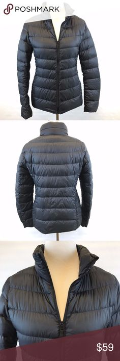 """Uniglo Puffer Jacket Coat Size Medium Down Womens Women's Uniqlo navy blue lightweight and packable down puffer jacket coat.  Full zipper front and zipper pockets in front and two open interior pockets.  Size Medium Shell:  100% nylon Fill:  90% down / 10% feather Lining:  100% nylon Bust underarm to underarm:   19"""" Length in back:  24"""" Shoulder to sleeve cuff:  25"""" Excellent, clean condition. Uniqlo Jackets & Coats Puffers"""