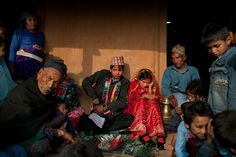 Nepal - Both boys and girls can be married too young. Here 15 year old Bishal accepts gifts while his 16 year old bride Surita sits unhappily at her new home.