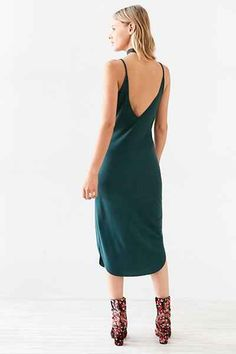 Sleeveless ribbed knit midi slip dress from Sparkle & Fade. In a stretchy ribbed knit with a slim, bodycon fit topped with a V-neck, V-back + spaghetti straps. Cut at mid-length with a curved hem.