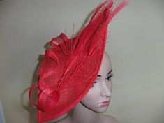 Stand out large red fascinator with matching peacock feather trim This diamond shape fascinator comes with a silver headband The total measurement is 15 1/2 by 8 I can make a similar one in other colours if required,please contact me.