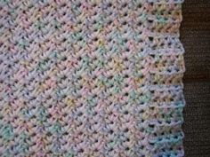 Crinkle Textured Baby Blanket  Here's another fairly easy baby blanket. This pattern creates a border as you go. The main stitch used in the body of the blanket is really easy to do, but makes a pretty crinkle pattern.